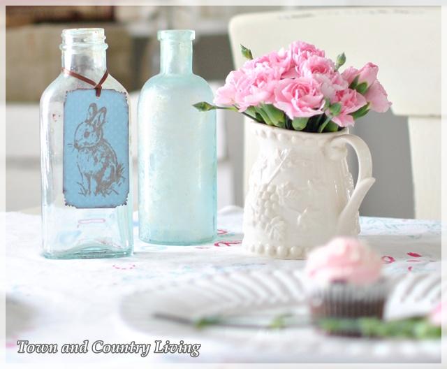 Pink carnations and aqua bottles