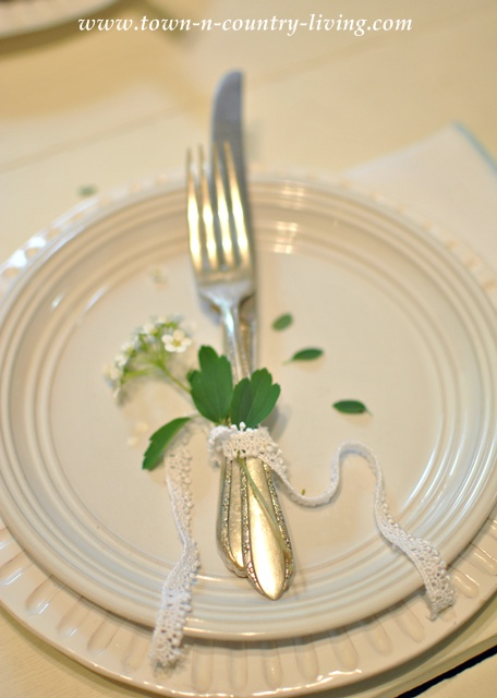 Dinner setting with white dishes - Town and Country Living blog