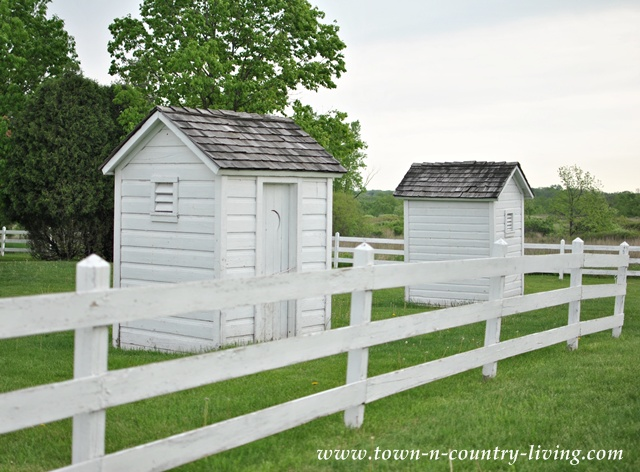Shabby white outhouses at Pioneer Sholes School