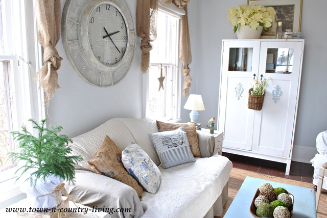 Summer farmhouse decorating tips town country living for Country farmhouse window treatments