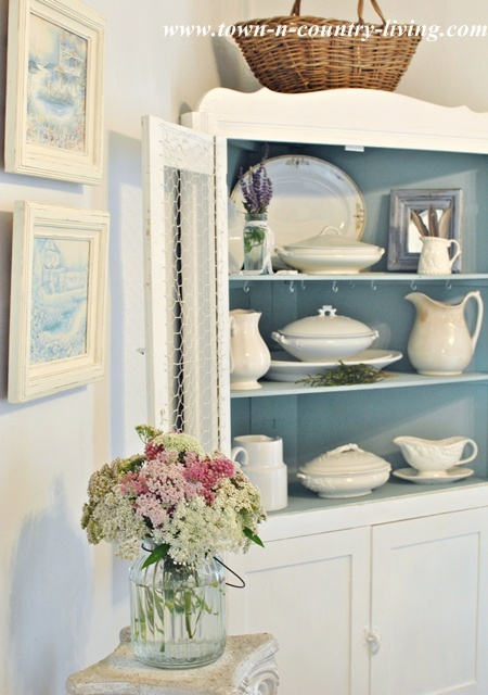 Dining hutch holds white ironstone