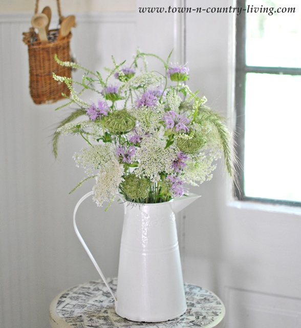 Purple and White Wildflowers in a White Enamel Pitcher