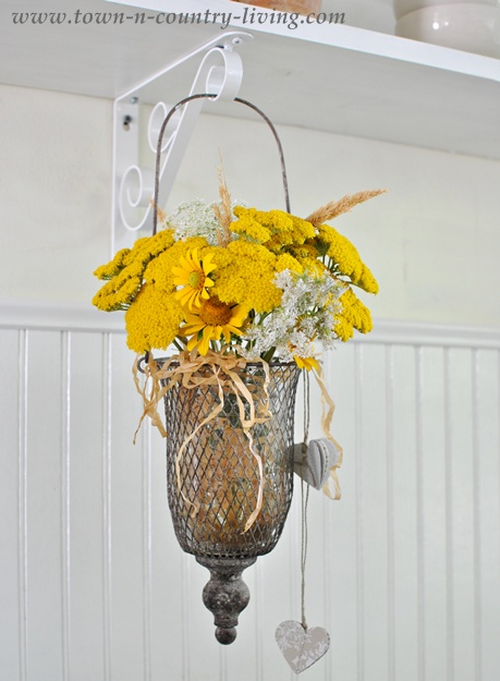 Yellow Wildflowers in a Farmhouse Country Kitchen via Town and Country Living
