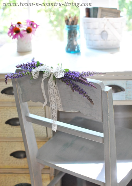 Flowers added to a painted desk chair via Town and Country Living