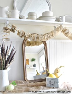 Vintage mirror and book page garland via Town and Country Living