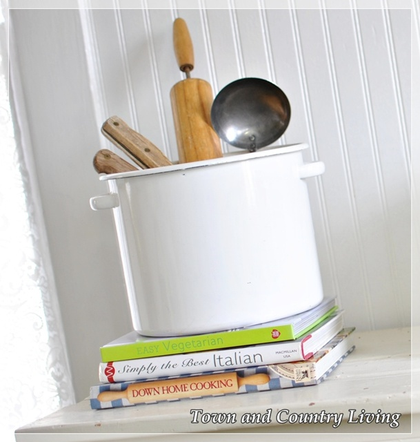 Wooden utensils in enamel pot via Town and Country Living