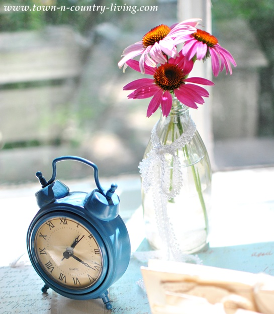 Blue tabletop alarm clock from Home Goods via Town and Country Living