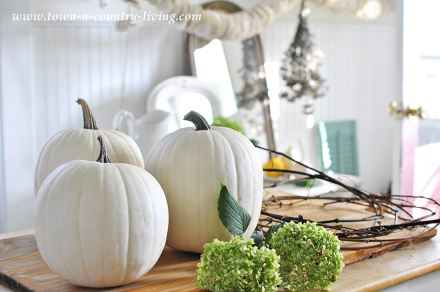 White pumpkins, grapeviine wreaths and hydrangeas via Town and Country Living