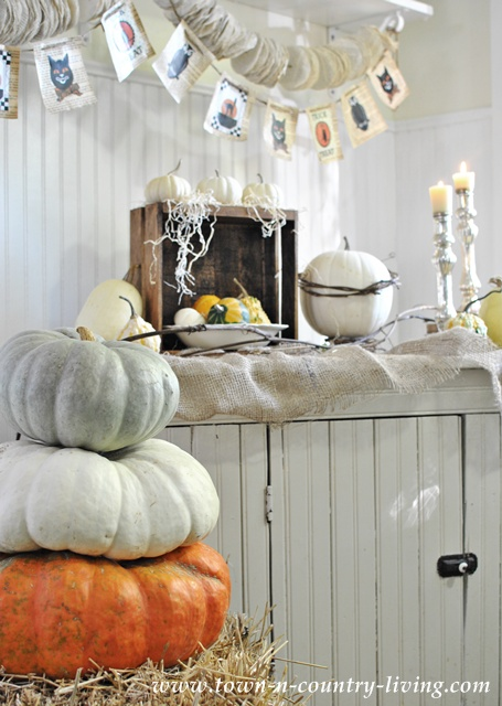 Stacked pumpkins for Halloween at Town and Country Living
