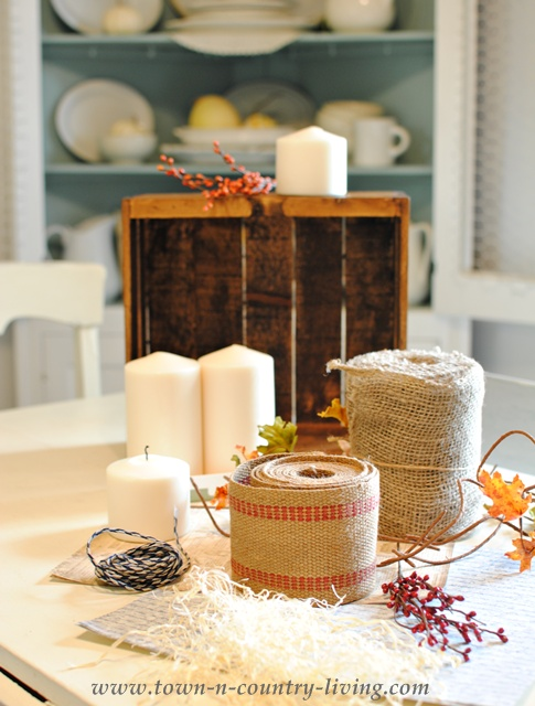 Supplies for making a fall centerpiece via Town and Country Living