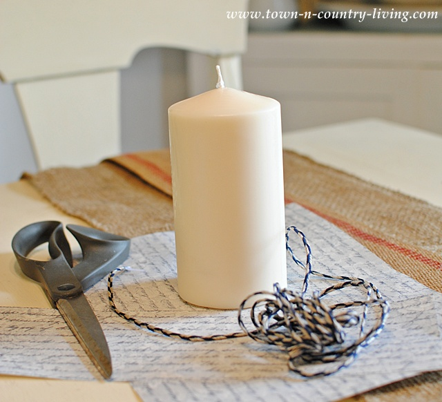 Decorate a candle with scrapbook paper via Town and Country Living