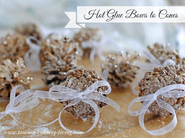 glue bows to pine cones - Pine Cone Ornaments