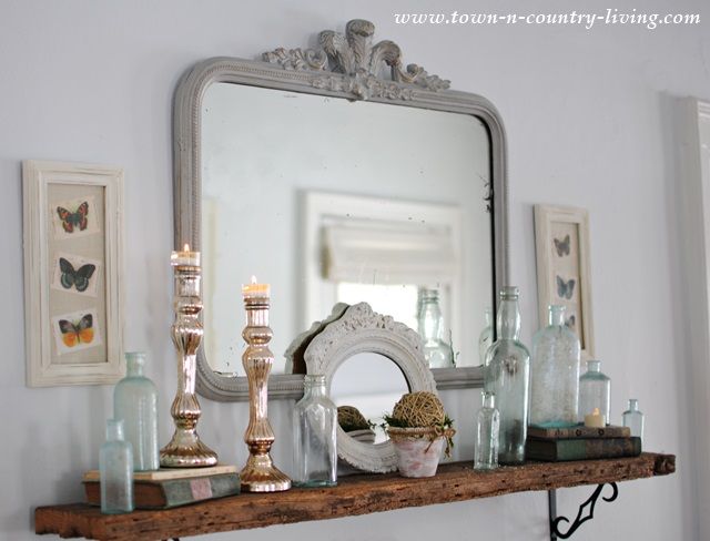 Glass and mirrors vignette at Town and Country Living