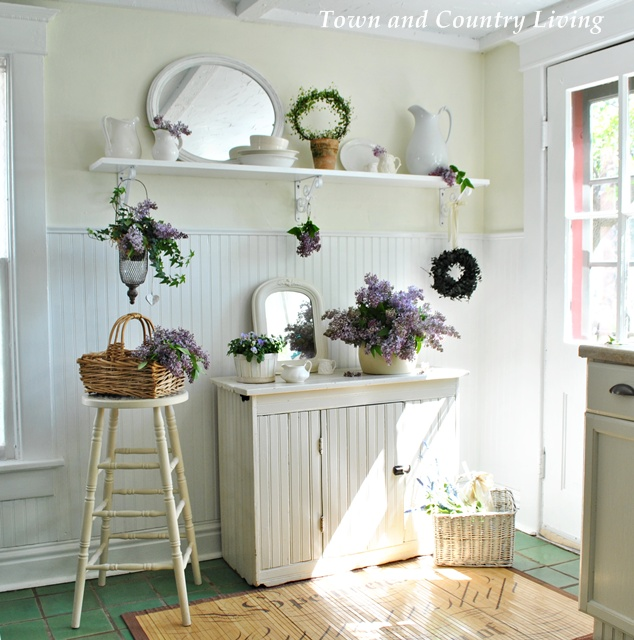 White ironstone and lilacs in a farmhouse kitchen