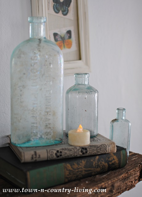 Vintage aqua bottles paired with vintage books
