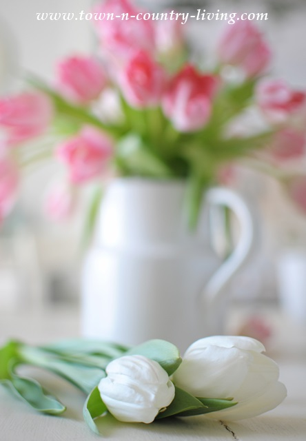 Pink and white tulips in white ironstone