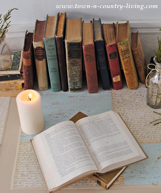 Colorful vintage books on a vintage desk