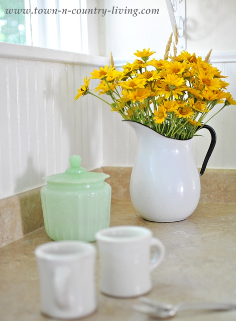 Yellow Wildflowers in a White Enamelware Pitcher
