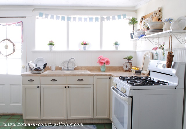 Simple Spring Decor in a Farmhouse Kitchen - Town & Country Living on small kitchen design white, decorating small space dining room, decorating top of kitchen cabinets, decorating above refrigerator, decorating ideas small spaces magazine,