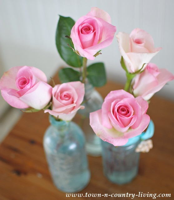 Springtime roses in vintage aqua vases
