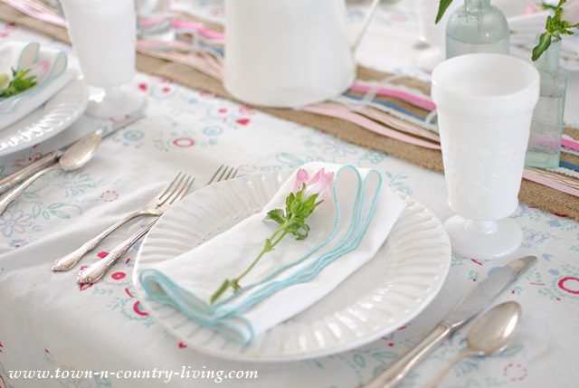 Spring table setting with vintage table cloth