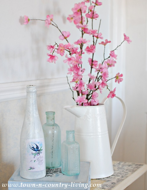 Spring blooms and white enamelware pitcher