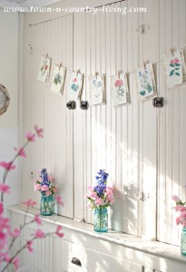 DIY botanical banner on a kitchen hutch