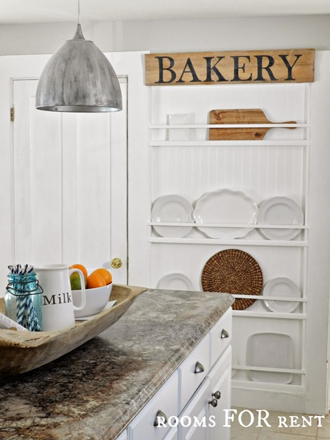 Plate rack wall in a cottage style kitchen