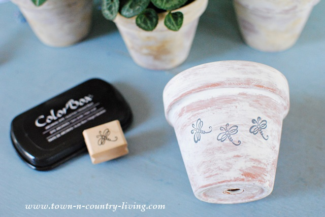 Stamping Whitewashed Clay Pots