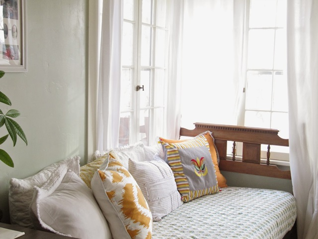Daybed surrounded by windows at Wicker House