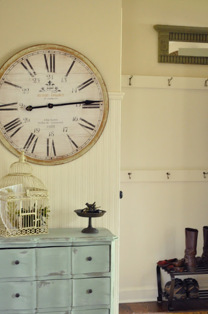 Front entry with convenient coat hooks and an oversized clock