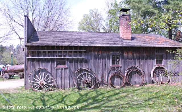 Historic Blacksmith with Old Wagon Wheels