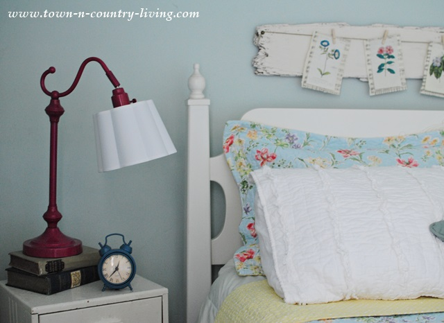 Farmhouse Bedroom with Raspberry Colored Lamp