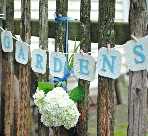 DIY Garden Banner on Rustic Fence