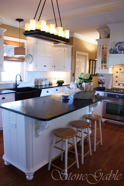Black countertops and white cabinets in a traditional style kitchen