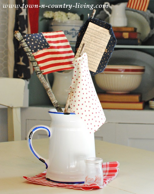 Patriotic Decorating with Mini Flags in Enamelware Pitcher