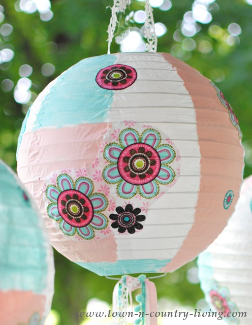 Paper lantern painted and decoupaged with pretty fabric.