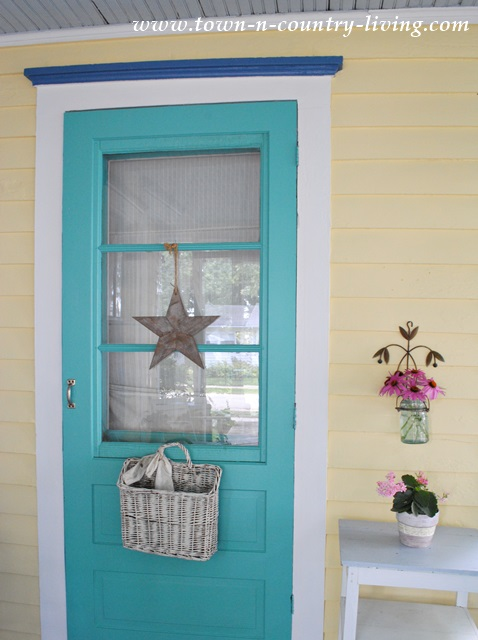 Took the leap and painted the front door a bold aqua color!