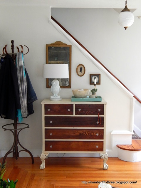 Vintage dresser in entry way creates storage for keys, mail, and more