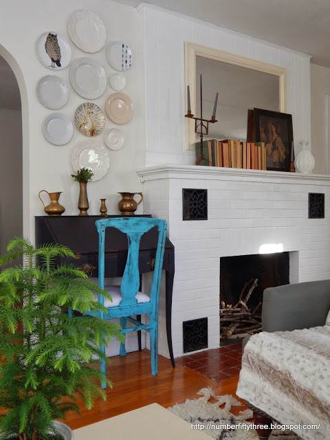 Painted brick fireplace in living room