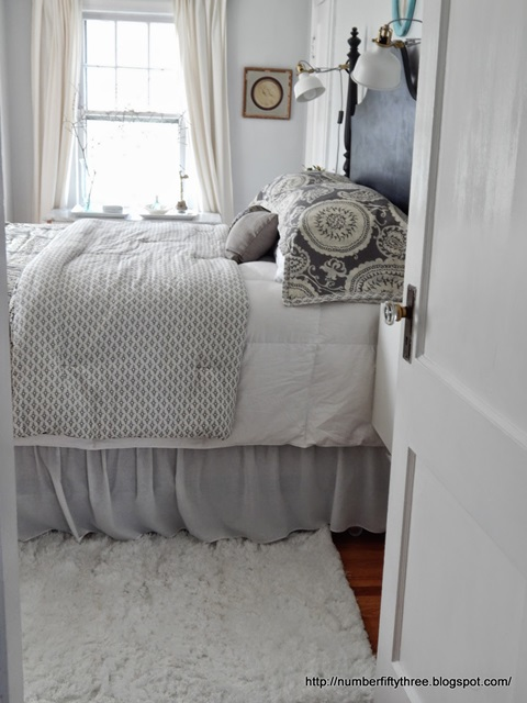 Neutral bedding adds class and elegance in an older home