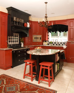 Bold, beautiful red kitchen cabinets look polished and pretty when paired with black.