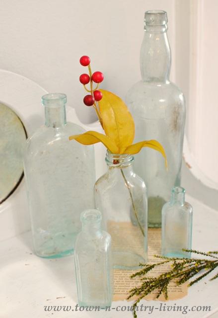 Vignette of vintage green glass bottles