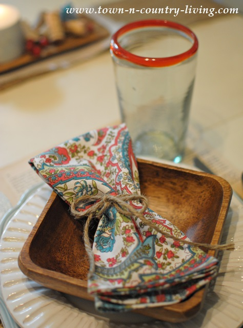 Paisley napkins add color to a rustic Fall table setting