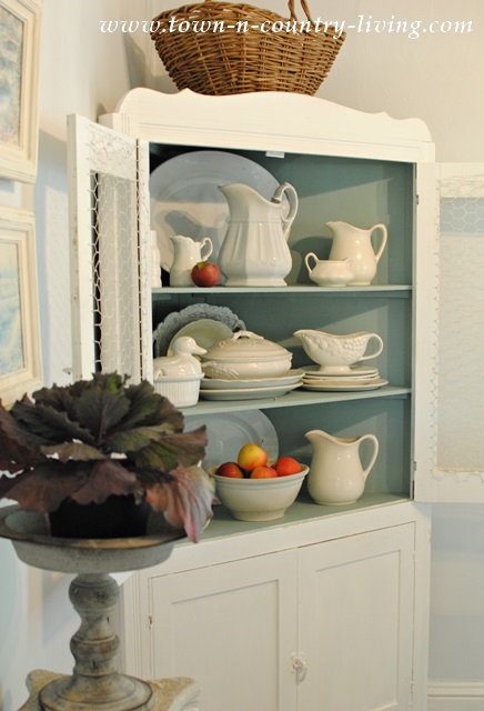 Farmhouse hutch filled with white ironstone