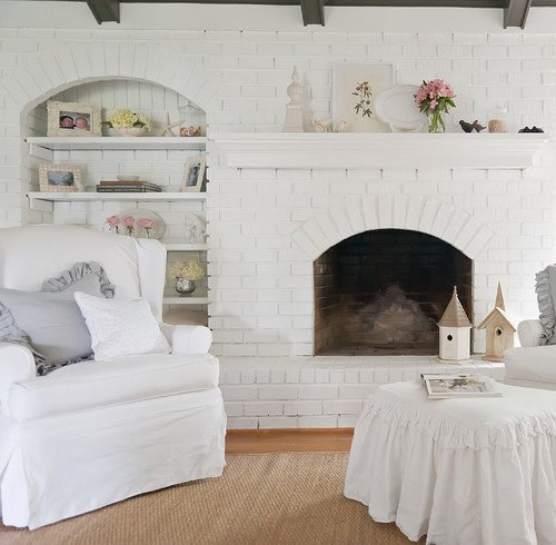 Cottage style fireplace painted white - perfect for shabby chic lovers!