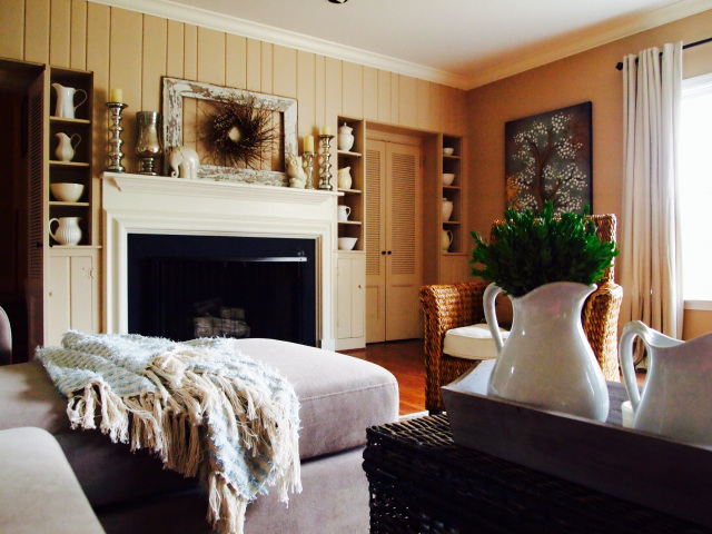 Home Decorating. A classic fireplace in a painted paneling room with rich hardwood floors.