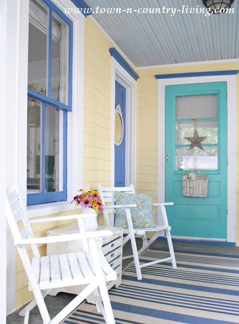 Decorating with bold colors town country living for Cottage colours exterior paints