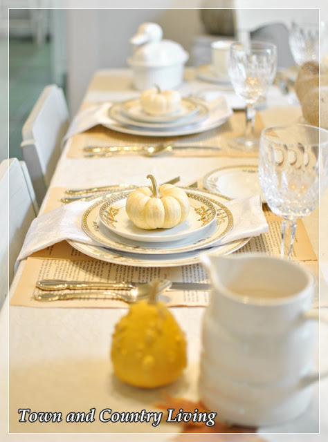 DIY Home Decor - Book pages are glued together to create simple place mats for this Thanksgiving table setting