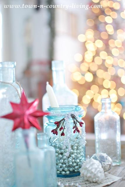 Vintage Aqua Bottles Create Christmas Vignette